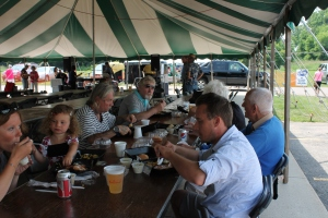 The Pala and Konecny families enjoy chicken dinner at the parish festival.