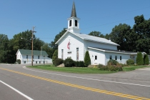 Vergennes United Methodist Church and Vergennes Township hall. Vergennes & Lowell townships surround the city of Lowell.