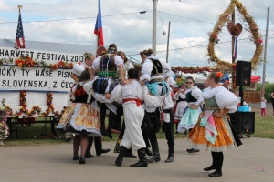 The men carry ladies up in a traditional Czech dance.