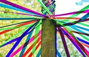May Day pole tied with ribbons signifies love and spring.